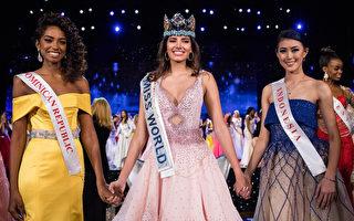 19歲波多黎各小姐斯蒂芬妮·德爾瓦萊(中)獲得2016年世界小姐后冠, 多明尼加小姐拉米雷斯(左)奪得亞軍,季軍是印尼小姐瑪努耶拉(右)。(ZACH GIBSON / AFP)