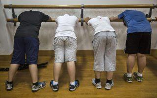 亚裔发胖多在身体中部,容易对身体造成严重影响。 (Kevin Frayer/Getty Images)