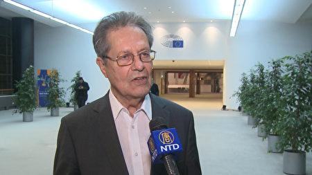 德国的欧洲议会议员克劳斯·布赫纳教授接受媒体采访。(新唐人)