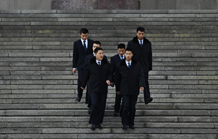 "Security personnel walk down the steps of the Great Hall of the People in Beijing on November 7, 2016. China effectively barred two elected pro-independence lawmakers from Hong Kong's legislature on November 7 after they deliberately misread their oaths, saying that they could not be sworn in again. An oath that did not conform to Hong Kong's law ""should be determined to be invalid, and cannot be retaken"", the Communist-controlled National People's Congress (NPC) in Beijing said in a rare interpretation of the semi-autonomous city's constitution. / AFP / GREG BAKER (Photo credit should read GREG BAKER/AFP/Getty Images)"