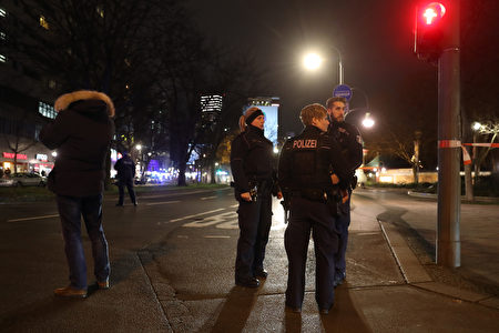 BERLIN, GERMANY - DECEMBER 19: Police stand near the area after a lorry truck ploughed through a Christmas market on December 19, 2016 in Berlin, Germany. Several people have died while dozens have been injured as police investigate the attack at a market outside the Kaiser Wilhelm Memorial Church on the Kurfuerstendamm and whether it is linked to a terrorist plot. (Photo by Sean Gallup/Getty Images)