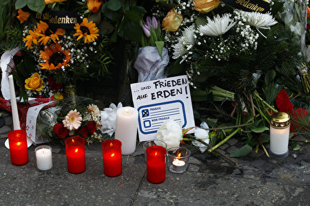 BERLIN, GERMANY - DECEMBER 20: A message reading freedom on Earth lays between flowers at the area after a lorry truck ploughed through a Christmas market on December 20, 2016 in Berlin, Germany. So far 12 people are confirmed dead and 45 injured. Authorities have confirmed they believe the incident was an attack and have arrested a Pakistani man who they believe was the driver of the truck and who had fled immediately after the attack. Among the dead are a Polish man who was found on the passenger seat of the truck. Police are investigating the possibility that the truck, which belongs to a Polish trucking company, was stolen yesterday morning. (Photo by Michele Tantussi/Getty Images)