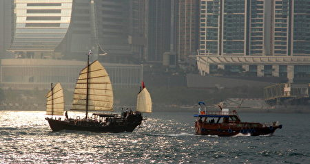 A modern junks (R) salis past a traditional junk in Hong Kong on March 14, 2011. A junk is an ancient Chinese sailing vessel design still in use today. Junks were developed during the Han Dynasty (206 BC–220 AD) and were used as sea-going vessels as early as the 2nd century AD. AFP PHOTO / LAURENT FIEVET (Photo credit should read LAURENT FIEVET/AFP/Getty Images)