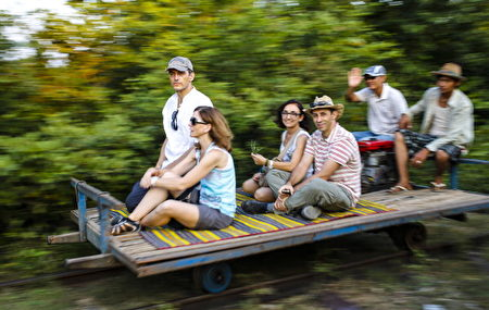 BATTAMBANG - DECEMBER 20: Tourists are riding the old fashioned bamboo train at Battambang on December 20, 2012, Cambodia. (Photo by EyesWideOpen/Getty Images)