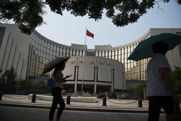 """专家认为,大陆地方政府债务高筑,""""中国金融泡沫成长难以想像""""。 (GREG BAKER/AFP/Getty Images)"""