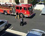 """位于柔斯密市山谷大道(Valley)上的华人客栈""""万利宾馆""""(Valley Hotel)在2015年7月27日发生命案,戴着黑帽的罹癌母亲被警方带走。(易小姐提供)"""