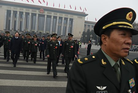 Military delegates walk away from the Great Hall of the People as they leave after a session of the Chinese People's Political Consultative Conference (CPPCC) in Beijing on March 4, 2016. China will raise its defence spending by seven to eight percent this year, a top official said on March 4, following years of double-digit increases as Beijing asserts its territorial claims in the South China Sea. AFP PHOTO / GREG BAKER / AFP / GREG BAKER (Photo credit should read GREG BAKER/AFP/Getty Images)