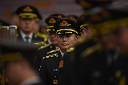 Members of a military band arrive for the closing session of the Chinese People's Political Consultative Conference (CPPCC) at the Great Hall of the People in Beijing on March 14, 2016. The CPPCC, a discussion body that is part of the Communist Party-controlled governmental structure, closed on March 14 after its 12-day annual session. / AFP / GREG BAKER (Photo credit should read GREG BAKER/AFP/Getty Images)