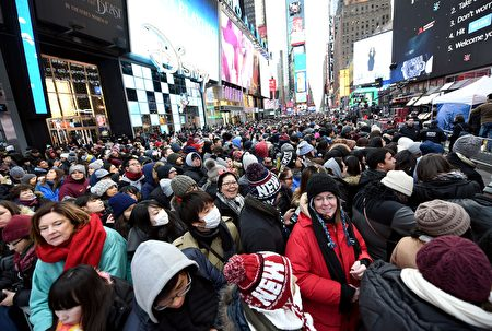 People gather in Times Square to celebrate New Year's Eve in New York on December 31, 2016. / AFP / ANGELA WEISS (Photo credit should read ANGELA WEISS/AFP/Getty Images)