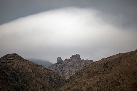 Misty clouds move through the desert near Lone Pine, California, January 8, 2017 as a series of strong storms moves into California. Californians braced for a series of major storms expected to hit the western state, bringing mudslides and power outages, but also much hoped-for relief from a six-year drought. Meteorologists said the storms, set to drench Northern California through part of next week, could be the heaviest in a decade. The stormy weather, described as a type of system called atmospheric rivers, come as the parched Golden State is experiencing its wettest winter in years. / AFP / DAVID MCNEW (Photo credit should read DAVID MCNEW/AFP/Getty Images)