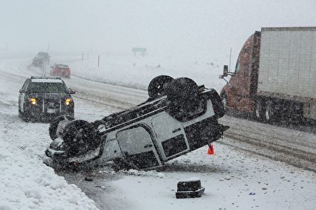 An overturned vehicle is seen on Highway 395 near Mammoth Lakes, California, January 9, 2017 as a series of strong storms moves through the western US state. / AFP / DAVID MCNEW (Photo credit should read DAVID MCNEW/AFP/Getty Images)