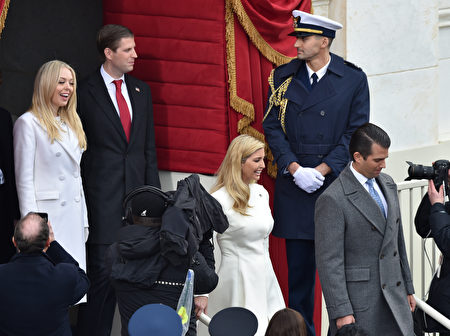 L-R: Tiffany Trump, Eric Trump, Ivanka Trump and Donald Trump Jr., arrive on the platform of the US Capitol in Washington, DC, on January 20, 2017, before the swearing-in ceremony of US President-elect Donald Trump. / AFP / Paul J. Richards (Photo credit should read PAUL J. RICHARDS/AFP/Getty Images)