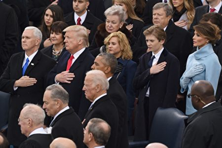 US Vice President Mike Pence, US President Donald Trump his wife Melania (R) and son Barron (2nd R) pray during the swearing-in ceremony as 45th President of the USA in front of the Capitol in Washington on January 20, 2017. / AFP / Timothy A. CLARY (Photo credit should read TIMOTHY A. CLARY/AFP/Getty Images)