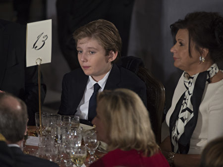 President Donald Trump's son Barron Trump attends the Inaugural Luncheon in Statuary Hall in the US Capitol following Donald Trump's inauguration as the 45th President of the United States, in Washington, DC, on January 20, 2017. / AFP / MOLLY RILEY (Photo credit should read MOLLY RILEY/AFP/Getty Images)