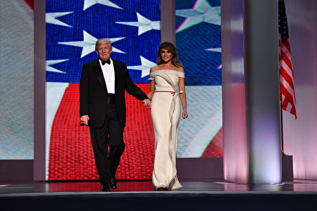 WASHINGTON, DC - JANUARY 20: President Donald Trump and First Lady Melania Trump arrive at the Freedom Ball on January 20, 2017 in Washington, D.C. Trump will attend a series of balls to cap his Inauguration day. (Photo by Kevin Dietsch - Pool/Getty Images)