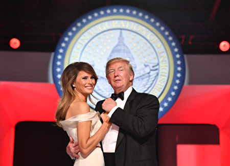 WASHINGTON, DC - JANUARY 20: President Donald Trump and First Lady Melania Trump dance at the Freedom Ball on January 20, 2017 in Washington, D.C. Trump will attend a series of balls to cap his Inauguration day. (Photo by Kevin Dietsch - Pool/Getty Images)