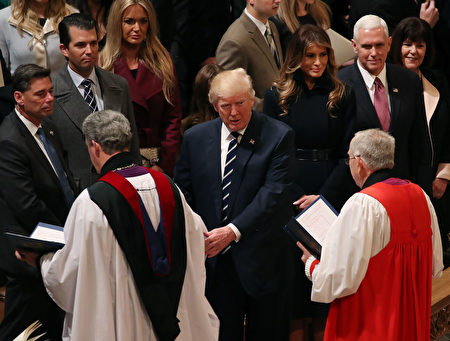WASHINGTON, DC - JANUARY 21: Members of the clergy walk past U.S. President Donald Trump and his wife first lady Melania Trump, Vice President Mike Pence, and his wife Karen Pence after National Prayer Service concluded at the National Cathedral, on January 21, 2017 in Washington, DC. (Photo by Mark Wilson/Getty Images)
