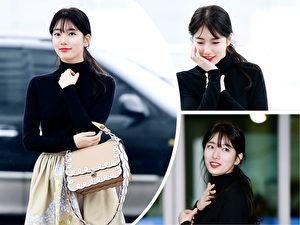 秀智一身知名品牌造型現身首爾仁川機場,準備前往米蘭出席 2017秋冬季時裝展。(FENDI/大紀元合成)