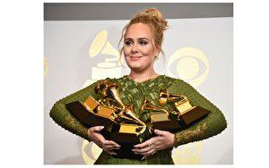 第59届格莱美奖于当地时间2月12日揭晓,入围5项的英国铁肺歌后阿黛尔(Adele)大满贯5奖全拿,(ROBYN BECK / AFP)