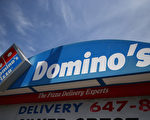近日,澳洲最大薄餅連鎖店達美樂(Domino's Pizza)一家分店被曝涉嫌向中國人販賣簽證,索要金額達15萬澳元(約11.6萬美元)。(Justin Sullivan/Getty Images)