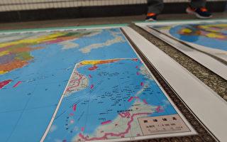 """美国海军一架P-3猎户座巡逻机,8日在南中国海附近,和中共一架JK-200侦察机有""""不安全""""的近距离接触,两机相距不到1千英尺。(GREG BAKER/AFP/Getty Images)"""