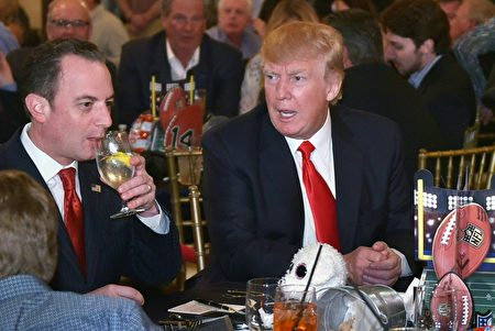 US President Donald Trump chats with White House Chief of Staff Reince Priebus while watching Super Bowl LI at Trump International Golf Club Palm Beach in West Palm Beach, Florida on February 5, 2017. / AFP / MANDEL NGAN (Photo credit should read MANDEL NGAN/AFP/Getty Images)