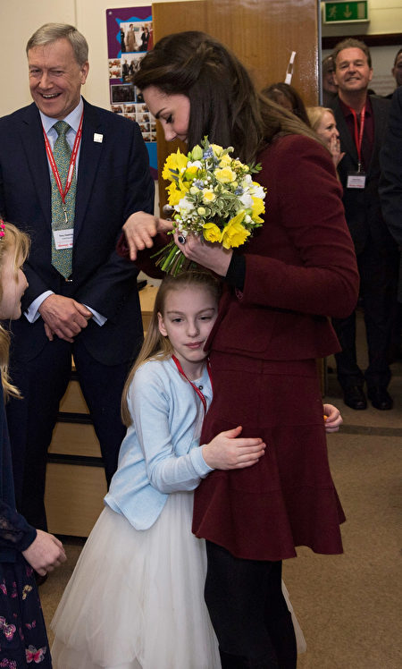 PONTYPOOL, WALES - FEBRUARY 22: Catherine, Duchess of Cambridge gets a hug from Ypapanti Galimatakis during her visit to MIST, a child and adolescent mental health project, part of Action for Children which supports vulnerable families in Wales and across the UK on February 22, 2017 in Pontypool, United Kingdom. (Photo by Paul Edwards - WPA Pool/Getty Images)