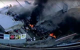 2月21日9点前,一架载有五人的飞机坠毁在Essendon Airport机场附近的DFO购物中心,引起了强烈爆炸。(新唐人视频截图)