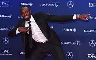 """牙买加""""飞人""""博尔特第四次获得劳伦斯最佳男运动员称号。 (Eamonn M. McCormack/Getty Images for Laureus)"""
