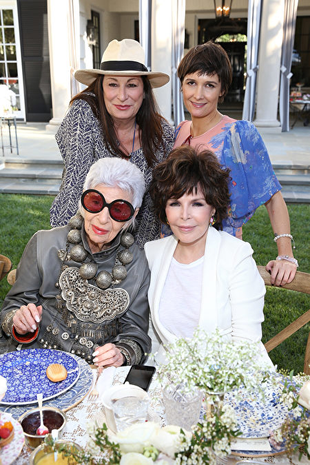 LOS ANGELES, CA - APRIL 27: (L-R) Anjelica Huston, Cassandra Huysentruyt Grey, Iris Apfel and Carole Bayer Sager attend VIOLET GREY's She's So Violet Garden Tea honoring Iris Apfel on April 27, 2015 in Los Angeles, California. (Photo by Jonathan Leibson/Getty Images for VIOLET GREY)