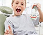 有些小儿在熟睡的时候会磨牙,牙齿磨得咯咯作响。(Fotolia)