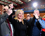 BALLYMENA, NORTHERN IRELAND - MARCH 03:  Michelle O'Neill, leader of Sinn Fein in Northern Ireland (C) celebrates winning her seat for Mid Ulster while surrounded by Francie Molloy, (L) and Ian Milne (R) at the Seven Towers Leisure Centre count in the Northern Ireland assembly election on March 3, 2017 in Ballymena, Northern Ireland. A snap election was called following the resignation of the Deputy First Minister Martin McGuiness, with indications showing that voter turnout yesterday was considerably higher than in May last year. The first declarations are expected around lunchtime today. (Photo by Jeff J Mitchell/Getty Images)