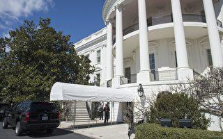 一名背包客男子上週五(3月10日)午夜前,違反安全規定,接近白宮行政官邸南大門入口處,被一名特勤人員發現及逮捕。(SAUL LOEB/AFP/Getty Images)