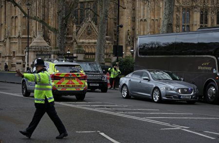 The Jagaur car of British Prime Minister Theresa May (R) is driven away from the Houses of Parliament in central London on March 22, 2017 during an emergency incident. / AFP PHOTO / Daniel LEAL-OLIVAS (Photo credit should read DANIEL LEAL-OLIVAS/AFP/Getty Images)