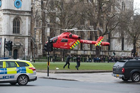 LONDON, ENGLAND - MARCH 22: An Air Ambulance at the scene by Westminster Bridge and the Houses of Parliament on March 22, 2017 in London, England. A police officer has been stabbed near to the British Parliament and the alleged assailant shot by armed police. Scotland Yard report they have been called to an incident on Westminster Bridge where several people have been injured by a car. (Photo by Jack Taylor/Getty Images)