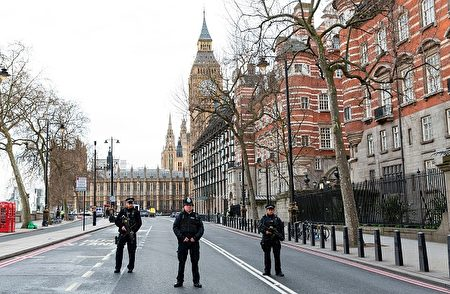 """Armed police officers stand on duty on The Embankment, near to the Houses of Parliament in central London on March 22, 2017, during an emergency incident. British police shot a suspected attacker outside the Houses of Parliament in London on Wednesday after an officer was stabbed in what police said was a """"terrorist"""" incident. One woman has died and others have """"catastrophic"""" injuries following a suspected terror attack outside the British parliament, local media reported on Wednesday citing a junior doctor. / AFP PHOTO / Joel Ford (Photo credit should read JOEL FORD/AFP/Getty Images)"""