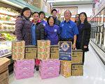 圖:參加食品捐助活動的獅會成員合影。(愛市獅會提供)