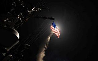 美國海軍發布的照片,導彈驅逐艦USS波特號在2017年4月7日在地中海發動對敘利亞基地空襲行動。( AFP PHOTO / US NAVY / Ford WILLIAMS)