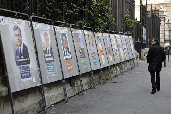 法国总统大选投票在即之际,巴黎发生导致数名警察死伤的袭击事件,这是否会影响到选民投票意向呢?(Ludovic MARIN/AFP)