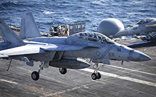 有專家認為,美國對北韓動武時,可能會對防空網、軍事指揮部、核武及導彈基地、核心核設施,進行破壞性定點打擊。圖為一架美國海軍F/A-18超級大黃蜂戰鬥機在航空母艦羅納德·里根號的甲板上降落。(Kim Hong-Ji/AFP)
