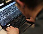 美國一家網絡安全公司週四(4月6日)表示,川習會前,疑似中共黑客入侵美國重要商業組織,試圖竊取美國大企業高管的帳號。(THOMAS SAMSON/AFP/Getty Images)
