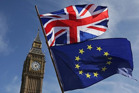 TOPSHOT - An EU flag and a Union flag held by a demonstrator is seen with Elizabeth Tower (Big Ben) and the Houses of Parliament as marchers taking part in an anti-Brexit, pro-European Union (EU) enter Parliament Square in central London on March 25, 2017, ahead of the British government's planned triggering of Article 50 next week. Britain will launch the process of leaving the European Union on March 29, setting a historic and uncharted course to become the first country to withdraw from the bloc by March 2019. / AFP PHOTO / Daniel LEAL-OLIVAS        (Photo credit should read DANIEL LEAL-OLIVAS/AFP/Getty Images)