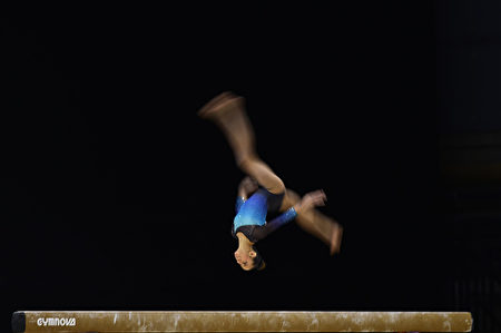 LIVERPOOL, ENGLAND- MARCH 26: Amelie Morgan of Slough Gymnastics competes in the beam during the British Gymnastics Championships at the Echo Arena on March 26, 2017 in Liverpool, England. (Photo by Nathan Stirk/Getty Images)