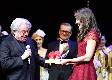 "LONDON, ENGLAND - APRIL 04: Producers Michael Grade and Michael Linnet present Catherine, Duchess of Cambridge with a set of tap shoes during the Opening Night Royal Gala performance of ""42nd Street"" in aid of the East Anglia Children's Hospice at the Theatre Royal Drury Lane on April 4, 2017 in London, England. (Photo by Steve Parsons - WPA Pool/Getty Images)"