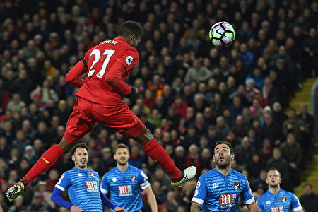 Liverpool's Belgian striker Divock Origi jumps to head their second goal during the English Premier League football match between Liverpool and Bournemouth at Anfield in Liverpool, north west England on April 5, 2017. / AFP PHOTO / PAUL ELLIS / RESTRICTED TO EDITORIAL USE. No use with unauthorized audio, video, data, fixture lists, club/league logos or 'live' services. Online in-match use limited to 75 images, no video emulation. No use in betting, games or single club/league/player publications. / (Photo credit should read PAUL ELLIS/AFP/Getty Images)