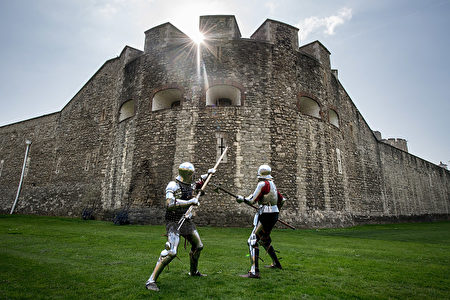 LONDON, ENGLAND - APRIL 06: Historical interpreters Mark Griffin (L) and Tom Fermor during a poleaxe fighting demonstration at the Tower of London, ahead of the 'Go Medieval at the Tower' festival at Tower of London on April 6, 2017 in London, England. The festival takes place from 29 April 2017 to 1 May 2017 and recreates the world of 1445 - offering knights sword fighting, crossbow shooting and appearances from Queen Margaret of Anjou and King Henry VI. (Photo by Chris J Ratcliffe/Getty Images)