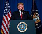 川普痛心地说,上帝的孩子不应该遭受这样的恐怖。只要美国站在正义一般,那么和平与和睦最终将会获胜。 (Photo credit should read JIM WATSON/AFP/Getty Images)