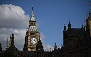 英首相宣布提前大选 获国会投票批准