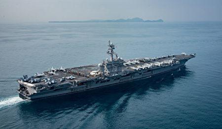 最近備受關注的美國卡爾文森號航母正在日本南部和日本空軍自衛隊一起聯合軍演。(Photo by Mass Communication Specialist 2nd Class Sean M. Castellano / U.S. Navy via Getty Images)
