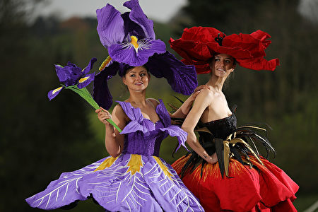 HARROGATE, ENGLAND - APRIL 19: Models Lauren Green (L) and Abi Moore pose for photographers as they wear an Iris and Poppy flower gowns designed by New Zealand artist, Jenny Gillies on April 19, 2017 in Harrogate, England. The flower gowns are just some of the many dresses being displayed at this year's Harrogate Spring Show between 20-23 April 2017. It is the first time that the creations by by the award winning New Zealand artist, Jenny Gillies have been displayed in the Northern Hemisphere . (Photo by Christopher Furlong/Getty Images)